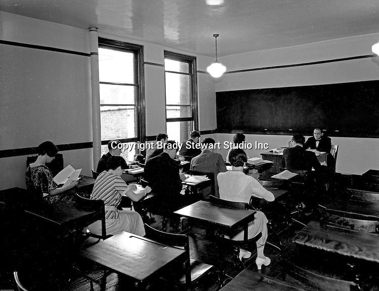 Pittsburgh PA:   Students taking a test in a college classroom - 1932