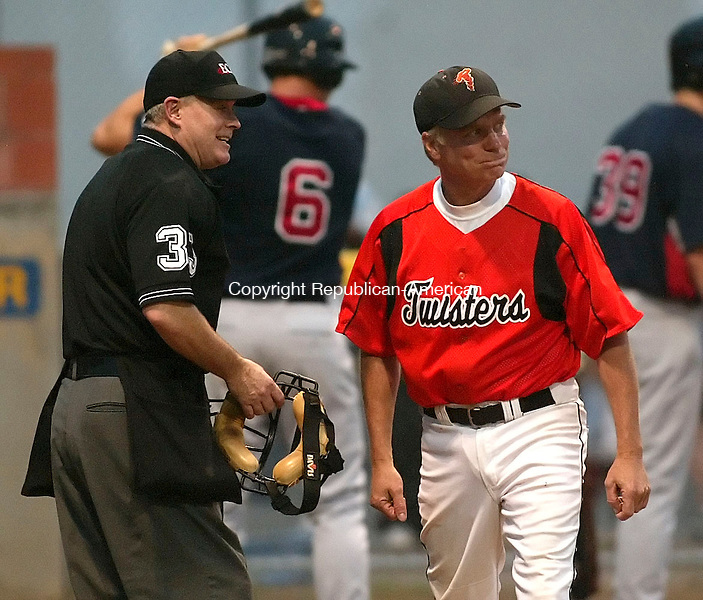 TORRINGTON, CT, 29 June 2006- 062906BZ06- Torrington Twisters'  head coach Gregg Hunt (1) walks away from the umpire after unsuccessfully arguing a Team USA player was out at the plate during their game at Fuessenich Park in Torrington Thursday night.<br /> Jamison C. Bazinet Republican-American