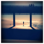 Runner passes under the Venice Pier on January 4, 2012.