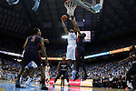 16 November 2014: North Carolina's Isaiah Hicks (22) is fouled by Robert Morris's Rodney Pryor (11). The University of North Carolina Tar Heels played the Robert Morris University Colonials in an NCAA Division I Men's basketball game at the Dean E. Smith Center in Chapel Hill, North Carolina. UNC won the game 103-59.