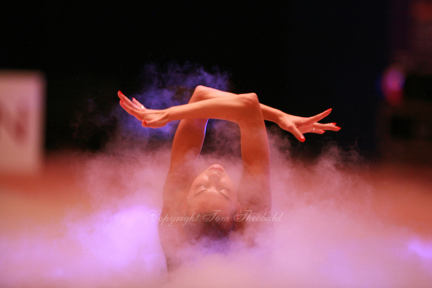 Natalya Godunko of Ukraine begins handsfree gala exhibition at 2006 Aeon Cup Worldwide Clubs Championships in rhythmic gymnastics on November19, 2006.  (Photo note: They used a smoke generator to cover floor with dry ice haze and slowly Natalya emerged to begin her exhibition... )<br />