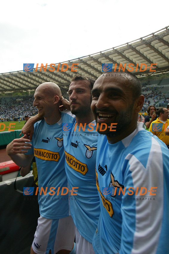 Roma 16/5/2004 Lazio Modena 2-1 Campionato Italiano Serie A 2003/2004 <br /> Jaap Stam (l) Giuseppe Favalli (C) and Fabio Liverani<br /> La Lazio festeggia, al termine della partita, la conquista della Coppa Italia avvenuta Mercoledi 12/5/2004 a Torino contro la Juventus. <br /> Lazio team celebrates, at the end of the championship match, Italy cup victory obtained on Wednesday, May 15 2004 against Juventus.  <br /> Photo Andrea Staccioli Insidefoto