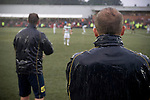 The New Saints manager Mike Davies watching the action through the rain at Park Hall Stadium, Oswestry during his team's Champions League 2nd qualifying round 2nd leg game with visitors Bohemians. Despite leading 1-0 from the first leg, the Dublin club went out following their 4-0 defeat by the Welsh champions. The match was the first-ever Champions League match in the UK played on an artificial pitch and was staged at the Welsh Premier League's ground which was located over the border in England.