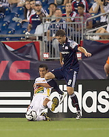 New England Revolution midfielder Chris Tierney (8) attempt to control the ball disrupted by Monarcas Morelia midfielder Jaime Lozano (21) tackle. The New England Revolution defeated Monarcas Morelia in SuperLiga 2010 group stage match, 1-0, at Gillette Stadium on July 20, 2010.