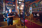 Liturgy service at St. Sava Orthodox Church, Jackson, Calif...Iconographer Miloje Milinkovic standing beneath his scaffolding in reverent silence during the Sunday liturgy service conducted by the.Very Reverend Stavrofor Miladin Garich, Father Stephen Tumbas and assisted by Dan Stojanovich.