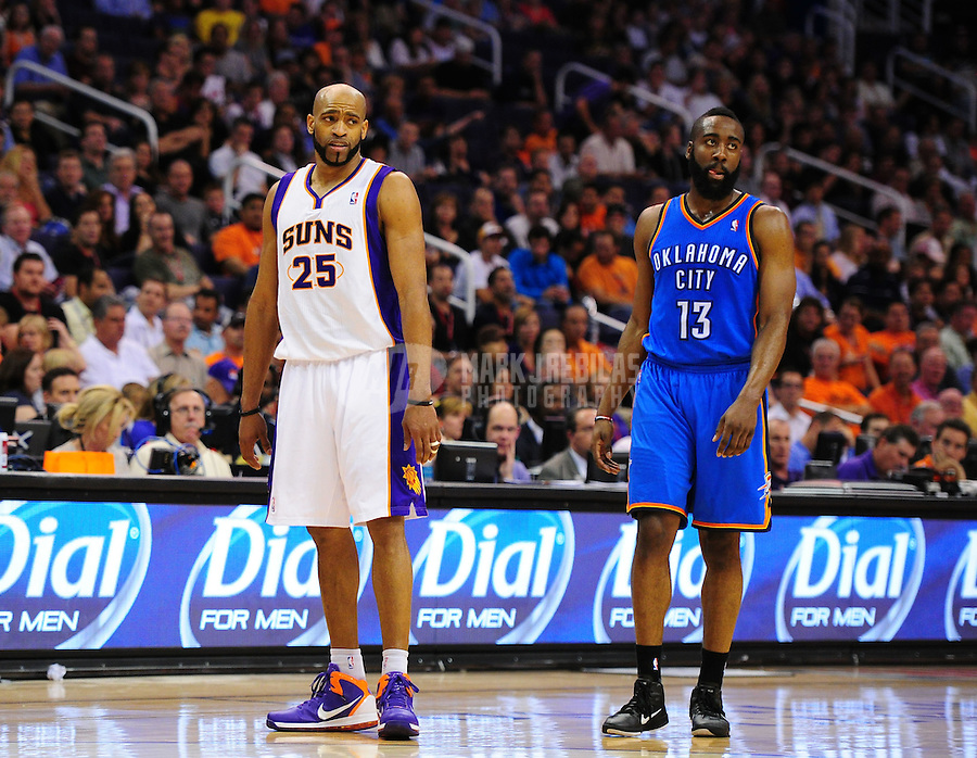 Mar. 30, 2011; Phoenix, AZ, USA; Oklahoma City Thunder guard (13) James Harden and Phoenix Suns guard (25) Vince Carter at the US Airways Center. Mandatory Credit: Mark J. Rebilas-