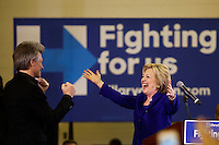 NEWARK, NJ - JUNE 01 : U.S. Democratic presidential candidate Hillary Clinton greets singer Jon Bon Jovi during a campaign rally on June 01, 2016 in Newark, New Jersey. Hillary Clinton only needs 73 delegates to clinch the party's nomination. on June 7 New Jersey will hold its primary elections, a state that will be awarding 142 total Democratic delegates. Photo by VIEWpress