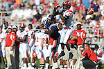 A pass is incomplete to Ole Miss wide receiver Melvin Harris (5) as Jacksonville State defensive back T.J. Heath (15)  defends at Vaught-Hemingway Stadium in Oxford, Miss. on Saturday, September 4, 2010. (AP Photo/Oxford Eagle, Bruce Newman)