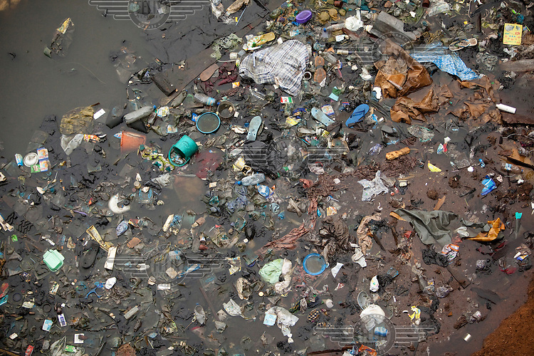 Rubbish in the water surrounding Lagos. Most sewage is released directly into the waters that surround the city of 18 million.