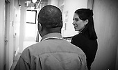 """Physician assistant Jen Vaupel chats with  Robert """"Bobby"""" Young's  before a check up at Bread for the City in Washington, DC."""
