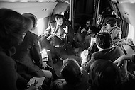 22 Jan 1980, USA --- Republican Presidential candidate George Bush on the campaign trail during the primary elections which he later lost to Ronald Reagan, who named him as Vice-President. Bush chats to journalists on board a plane during campaigning between Maine and Vermont. --- Image by © JP Laffont