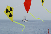 YELLOW &quot;STOP PLUTONIUM&quot; KITES, AND THE JAPANESE COAST GURAD SHIP THAT ESCORTED THE MVAS, JAPAN. 030702..PIC &copy; JEREMY SUTTON-HIBBERT/GREENPEACE 2002..*****ALL RIGHTS RESERVED. RIGHTS FOR ONWARD TRANSMISSION OF ANY IMAGE OR FILE IS NOT GRANTED OR IMPLIED. CHANGING COPYRIGHT INFORMATION IS ILLEGAL AS SPECIFIED IN THE COPYRIGHT, DESIGN AND PATENTS ACT 1988. THE ARTIST HAS ASSERTED HIS MORAL RIGHTS. *******