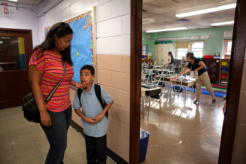Yokayra Fernandez-Haghighi spends time with her son Jesus Haghighi, 7, before his 2nd-grade class starts at PS85 in Fordham Heights, The Bronx, NY on September 11, 2013.