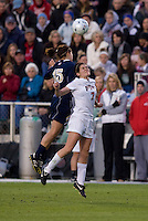 Rose Augustin (15) of Notre Dame goes up for a header with Elizabeth Sullivan (7) of Ohio State during the first game of the NCAA Women's College Cup at WakeMed Soccer Park in Cary, NC.  Notre Dame defeated Ohio State, 1-0.