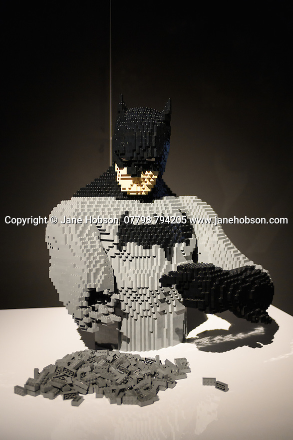 THE ART OF THE BRICK: DC SUPER HEROES - Artist Nathan Sawaya returns to London with the world's largest LEGO exhibition, inspired by Batman, Superman, and Wonder Woman. The exhibition opens, in a purpose-built marquee in Doon Street car park, Upper Ground, on the South Bank. Picture shows: Building Batman