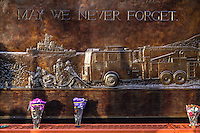NEW YORK, NY - SEPTEMBER 11, 2016: Flowers rest on a memorial Wall Located at FDNY Engine and Ladder 10 during the 15th anniversary of the 9/11 attacks on September 11, 2016 in New York. Photo by (VIEWpress/Maite H. Mateo)