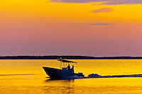 Boat  off of the Kona Kai resort at sunset, Key Largo, Florida Keys, Florida USA