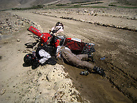 Day 5, another enemy out in the wakhan is mud. in a thick patch my bike spins out and i crash and break my camera lens. What do war correspondences do on the holidays. 4 Kabul based journalists were the first westerners to ride motorcycles into the Wakhan corridor.the 12 day trip was full with dramas, breakdowns, arrests, crashes, yak riding and many miles. over 1200 kms they travelled and reached their desired destination of surhad e brogil deep in the wakhan corridor. location of the great game and once named the roof of the world.