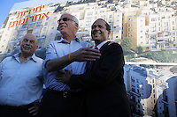 Israeli Housing Minister Uri Ariel ( C ) hugs Jerusalem Mayor Nir Barkat ( R ) during a corner stone laying ceremony for a new Jewish neighborhood on August 11, 2013 in East Jerusalem, Israel. Israel's Housing Ministry announced Sunday the marketing of land for the immediate construction of nearly 1,200 new units in Jewish neighborhoods in East Jerusalem and the West Bank settlement blocs.   Photo by Oren Nahshon