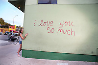 """The """"i love you so much"""" mural is affixed to the South Congress Shopping District """"Keep Austin Weird"""" culture."""