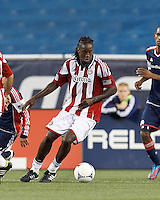 Chivas USA midfielder Shalrie Joseph (18) brings the ball forward. In a Major League Soccer (MLS) match, the New England Revolution tied Chivas USA, 3-3, at Gillette Stadium on August 29, 2012.
