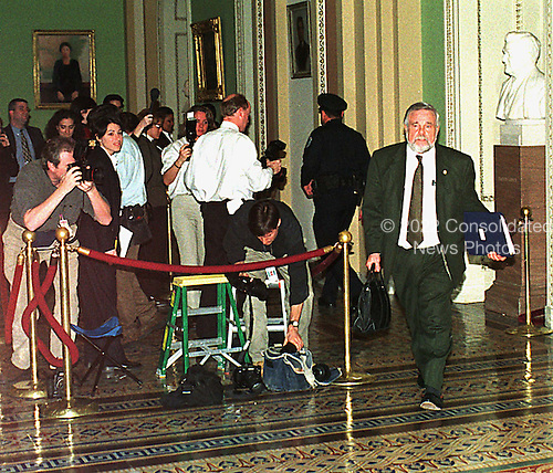 United States House Judiciary Committee Chief Majority Counsel for the Impeachment David Schippers walks past reporters and photographers outside the U.S. Senate Chamber in the U.S. Capitol in Washington, D.C. on January 14, 1999..Credit: Ron Sachs / CNP