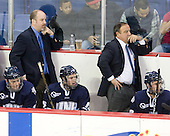 Connor Hardowa (UNH - 2), Scott Borek (UNH - Associate Head Coach), Brett Kostolansky (UNH - 15), Dick Umile (UNH - Head Coach) - The visiting University of New Hampshire Wildcats defeated the University of Massachusetts-Lowell River Hawks 3-0 on Thursday, December 2, 2010, at Tsongas Arena in Lowell, Massachusetts.