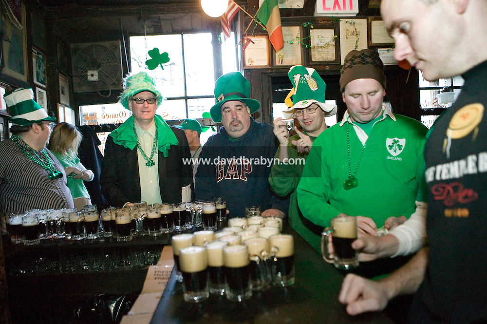 17 March 2006 - New York City, NY - Barely awake customers celebrate St Patrick's day at McSorley's pub in New York City, 17 March 2006. Every year McSorley's, one of New York's most famous Irish pubs, opens - and fills up immediately - at 8am on St Patrick's day.