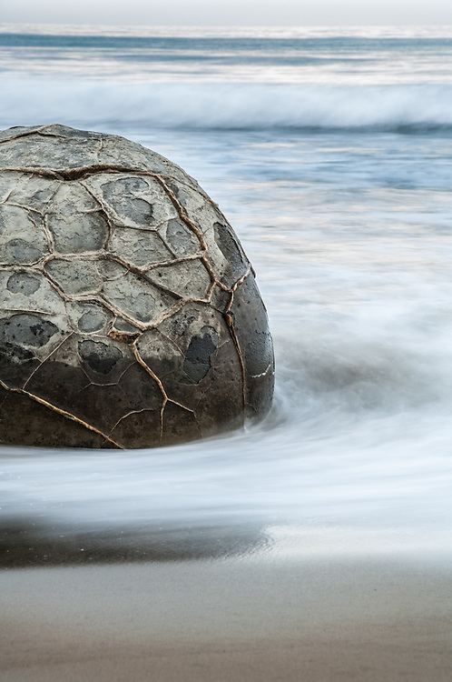 Moeraki Boulder surrounded by waves. Otago, South Island, New Zealand - stock photo, canvas, fine art print