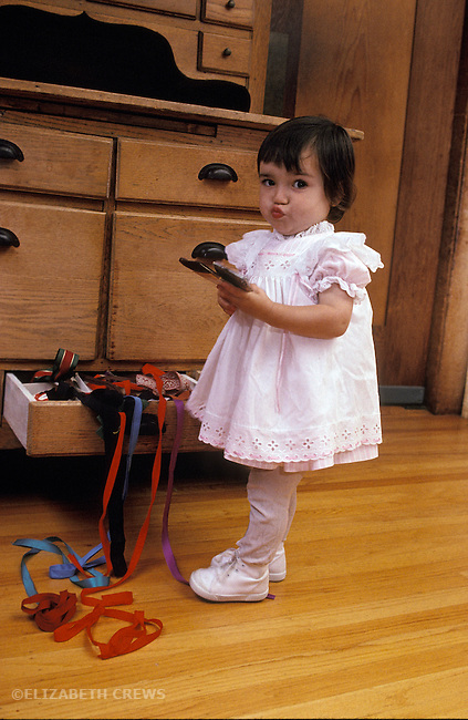 Berkeley CA 2-yr-old feeling guilty, knowing she's done something wrong by getting into forbidden drawers MR