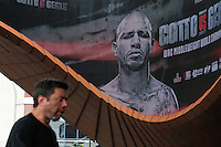 A man walks near a display of Puerto Rico boxer Miguel Cotto during an official weigh-in ahead of his fight against at Barclays Center in New York.  06/05/2015. Eduardo MunozAlvarez/VIEWpress