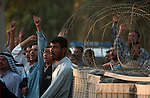 Iraqi Shiites demonstrate October 1, 2003  against the detention of local Shia cleric Sheik Salah outside the al-Baya'a mosque in Baghdad, Iraq.
