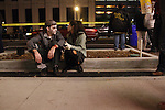 A couple of zombies sit outside the Kentucky Theatre before the beginning of the Thriller Zombie parade, Sunday, Oct. 30, 2011. Photo by Brandon Goodwin | Staff.