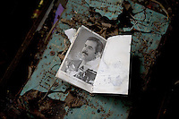 DEU, Deutschland, Germany, Berlin, 18.08.2010.Brochure with photo of Saddam Hussein. The former and now abandoned Iraqi embassy to communist East Germany in Berlin-Pankow, deserted by its staff nearly 20 years ago, has turned into a dilapidated ghost embassy of the long vanished Saddam Hussein era. The old site built in pre-fabricated socialist style is now diplomatic no-man's land. Most of what the Iraq embassy staff left behind of their abandoned offices in a hurry in January 1991 is still there twenty years later. Germany, German, symbolic picture, Architecture, politics, Iraqi embassy, GDR, East Berlin, East-Berlin.v.[(c) Stefan Boness/Ipon - Veroeffentlichung nur gegen Honorar (zuzuegl. MwSt.), Namensnennung und Beleg; Kto.: 940165350, Bln. Spk., BLZ 100 500 00; Claudiusstr. 6, 10557 Bln, Phone: ++49-(0)30-3934318, www.iponphoto.com, e-mail: boness@iponphoto.com; No Model Release. Vereinbarungen ueber Model Release / Abtretung von Persoenlichkeitsrechten der abgebildeten Person/Personen liegen nicht vor.]