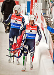 4 December 2015: Ludwig Rieder and Patrick Rastner (carrying the sled), sliding for Italy, leave the track after their second run, finishing 12th for the day with a combined time of 1:28.900 in the Doubles Competition of the Viessmann Luge World Cup at the Olympic Sports Track in Lake Placid, New York, USA. Mandatory Credit: Ed Wolfstein Photo *** RAW (NEF) Image File Available ***