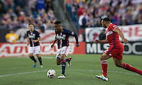 Foxborough, Massachusetts - May 14, 2016: First half action. In a Major League Soccer (MLS) match, the New England Revolution (blue/white) vs Chicago Fire (red), 1-0 (halftime), at Gillette Stadium.