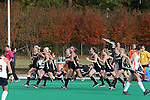 09 November 2014: Wake Forest players race onto the field in celebration after the game. The Wake Forest University Demon Deacons played the Syracuse University Orange at Jack Katz Stadium in Durham, North Carolina in the 2014 Atlantic Coast Conference NCAA Division I Field Hockey Championship Game. Wake Forest won the ACC Championship game 2-0.