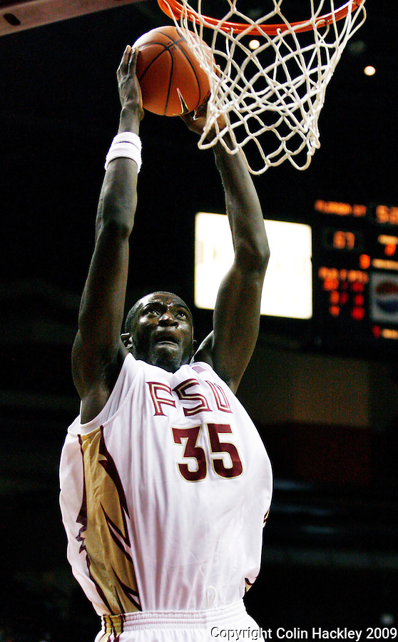 TALLAHASSEE, FL 11/3/09-FSU-DELTA BB09 CH35-Florida State's Solomon Alabi slams during second half action against Delta State's Tuesday at the Tallahassee-Leon County Civic Center. EDITORS NOTE: Alabi normally wears # 31 but tore his jersey in the game and wore #35 in the second half. The Seminoles beat the Statesmen 81-38 in their first exhibition game of the season...COLIN HACKLEY PHOTO