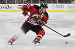 Mar 27; Newark, NJ, USA; New Jersey Devils left wing Zach Parise (9) skates with the puck during the second period of their game against the Chicago Blackhawks at the Prudential Center.