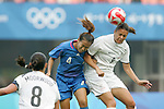 06 August 2008: Azuse Iwashimizu (JPN) (4) and Amber Hearn (NZL) (9) challenge for a header.  The women's Olympic team of New Zealand tied the women's Olympic soccer team of Japan 2-2 at Qinhuangdao Olympic Center Stadium in Qinhuangdao, China in a Group G round-robin match in the Women's Olympic Football competition.