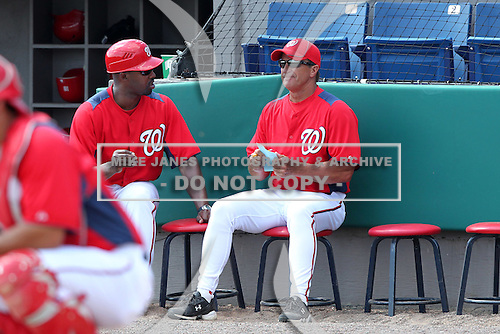 Washington Nationals Jim Riggleman #5 talks with Bo Porter during a spring training game against the Florida Marlins at Spacecoast Stadium on March 27, 2011 in Melbourne, Florida.  Photo By Mike Janes/Four Seam Images