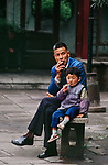 00549_08, Shanghai, China, 1989, families, CHINA-10066. A boy and his father sit outside. <br />