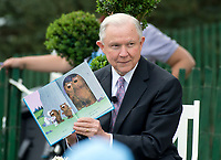 United States Attorney General Jeff Sessions reads &quot;It's Not Easy Being a Bunny&quot; to a group of children during the annual Easter Egg Roll on the South Lawn of the White House in Washington, DC prior to the arrival of US President Donald J. Trump and first lady Melania Trump on Monday, April 17, 2017.<br /> CAP/MPI/CNP/RS<br /> &copy;RS/CNP/MPI/Capital Pictures