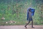 A boy walks in the rain on a path through Mizak, a small village in the south of Haiti.