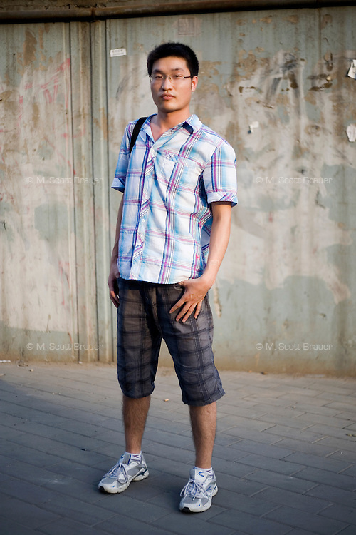 Zhangcuibao, a programmer, age 24, poses for a portrait in Beijing. Response to 'What does China mean to you?': 'Beloved mother country.'  Response to 'What is your role in China's future?': 'More and more powerful and wealthy.'