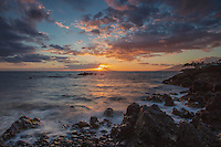 A view of the setting sun from the beach at Makena State Park, southern Maui.