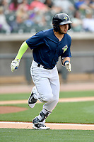 Shortstop Michael Paez (3) of the Columbia Fireflies runs toward first in a game against the Lexington Legends on Sunday, April 23, 2017, at Spirit Communications Park in Columbia, South Carolina. Lexington won, 4-2. (Tom Priddy/Four Seam Images)