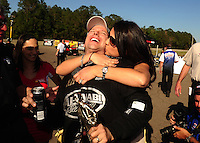 Mar. 13, 2011; Gainesville, FL, USA; NHRA top fuel dragster driver Del Worsham is kissed by his wife Connie Worsham after winning the Gatornationals at Gainesville Raceway. Mandatory Credit: Mark J. Rebilas-