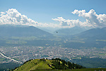 View of a hang-glider from the Seegrube Panorama Trail which starts from Seegrube station at 6,250 feet and part of Karwendel Nature Park, the largest nature park in Austria; offers views of Innsbruck and the valley below