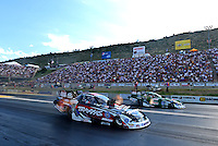 Jul, 20, 2012; Morrison, CO, USA: NHRA funny car driver Courtney Force (near lane) races alongside her father John Force during qualifying for the Mile High Nationals at Bandimere Speedway. Mandatory Credit: Mark J. Rebilas-US PRESSWIRE